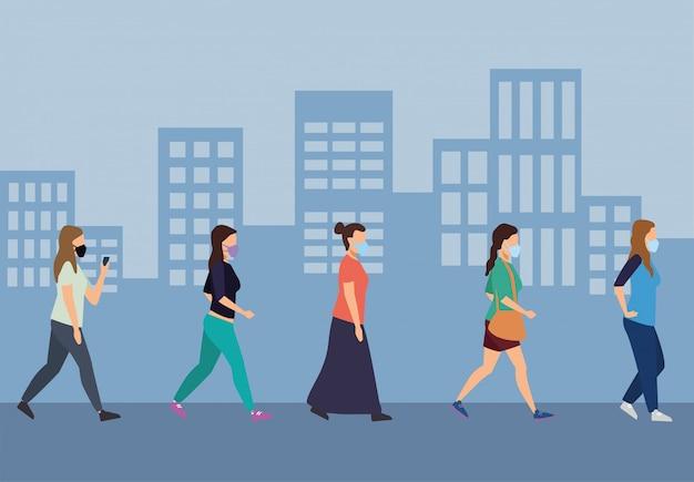도시 문자에 의료 마스크를 착용하는 젊은 여성 그룹