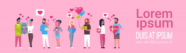 Group of people holding presents on template pink valentine day holiday concept