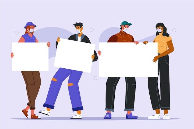 Gruppo di persone in maschere mediche con cartelli