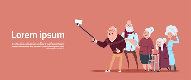 Group of senior people taking selfie photo with self stick modern grandfather and grandmother