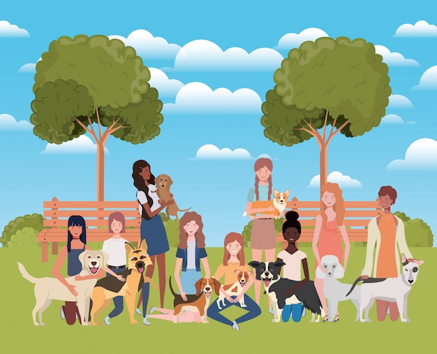 Group of women with cute dogs in the park