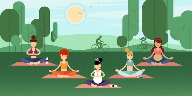Group of yoga girls in a summer park.