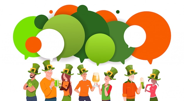 Group of young people in leprechaun hats over chat bubbles background celebrate saint patrick day