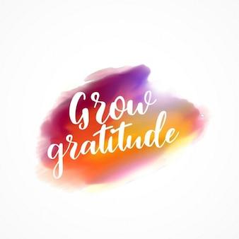 Macchia acquerello con il messaggio crescere gratitudine