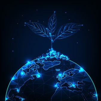 Growth and development concept with glowing low polygonal plant sprout planted on the planet earth