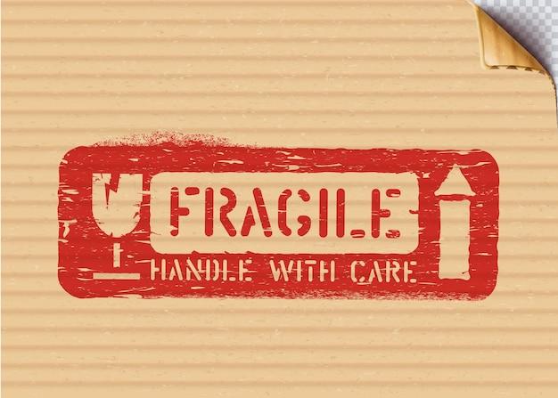 Grunge fragile sign on cardboard box for logistics or cargo