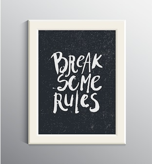 Grunge ink hand drawn quote in white frame on the wall. break some rules. inspirational quote, phrase, t-shirt print. lettering