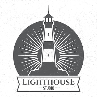 Grunge lighthous silhouette logo or label