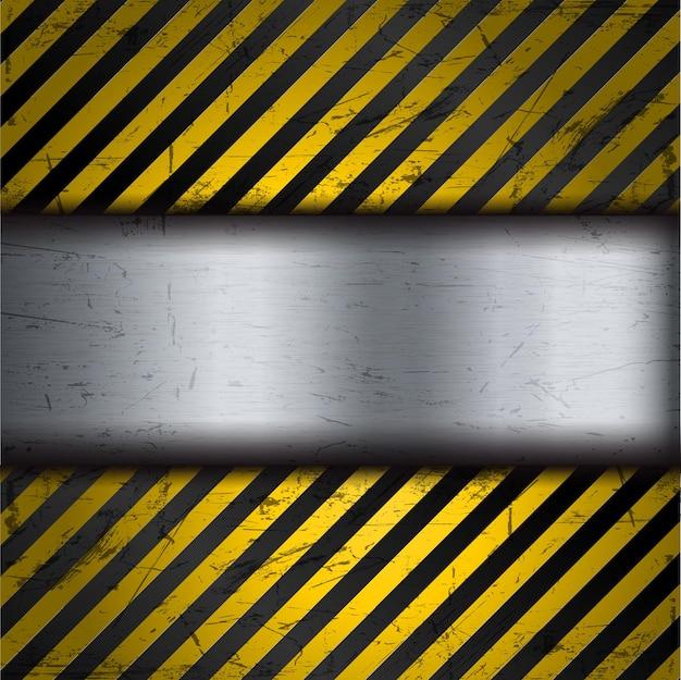 黄色と黒の警告ストライプとグランジ金属背景