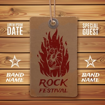 Grunge, rock n roll sign and fire on vintage price tag and wooden planks.