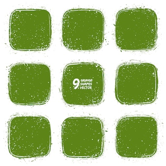 Grunge textured green shapes vector set