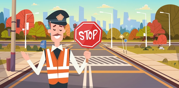 Guard with stop sign on road with crosswalk and traffic lights