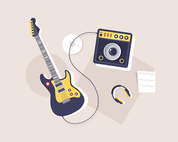 ギターと楽器、エレクトリック・ギター、ペダルボードとチューブ・アンプの隣のギター