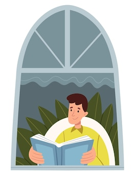 A guy in bright clothes is reading in front of the window.