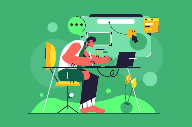Парень-дизайнер занимается компьютерной иллюстрацией.