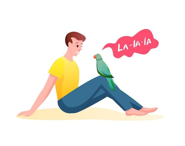 Парень сидит и слушает пение попугая, заботится о птице.