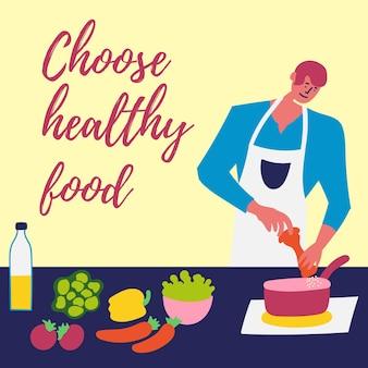 Парень готовит здоровую еду на сковороде на кухне солевой суп здоровое питание