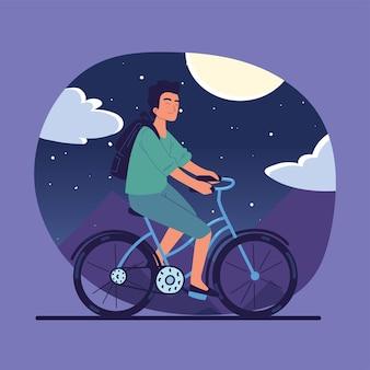 男は自転車に乗る
