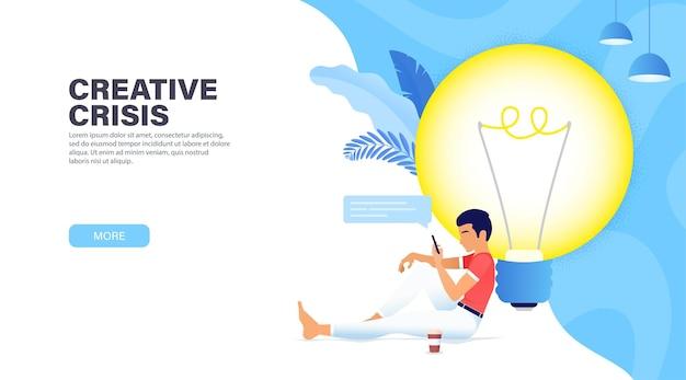大きな白熱電球の近くに座って、プロジェクトの新しいアイデアを探している男
