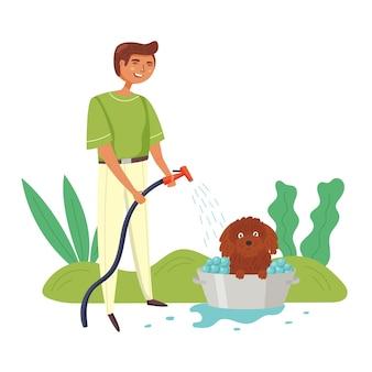 The guy washes dog basin hose water