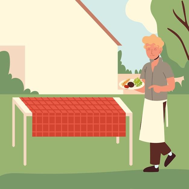 Парень с барбекю на заднем дворе