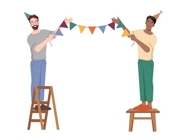 Ребята вешают праздничные флаги на веревку, готовясь к дню рождения, кавказские и афроамериканские парни