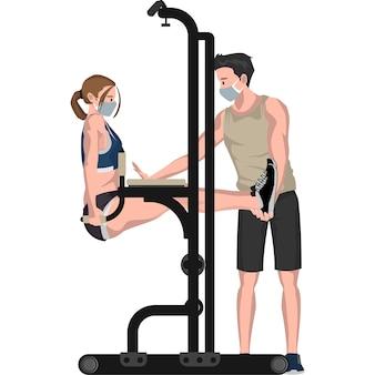 체육관 회원에게 체육관 장비 사용법을 가르치는 체육관 교사