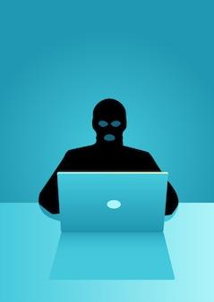 Hacker behind laptop computer