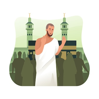Hajj pilgrim in ihram clothes praying in front of kaaba