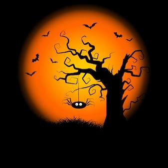 ぶら下がっているクモと不気味な木とハロウィーンの背景