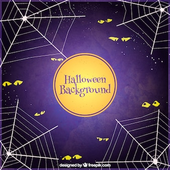 Halloween background with eyes and spider web