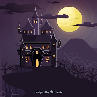 Halloween background with haunted house on a hill