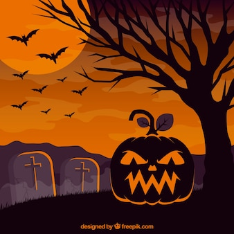 Halloween background with pumpkin in the cemetery