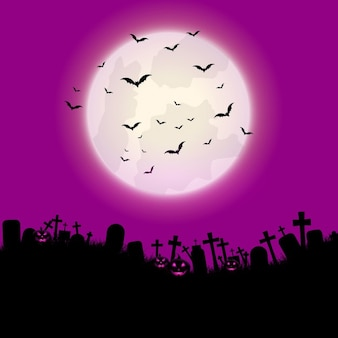 Halloween background with pumpkins and graveyard