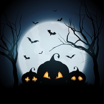 Halloween background with pumpkins in spooky landscape