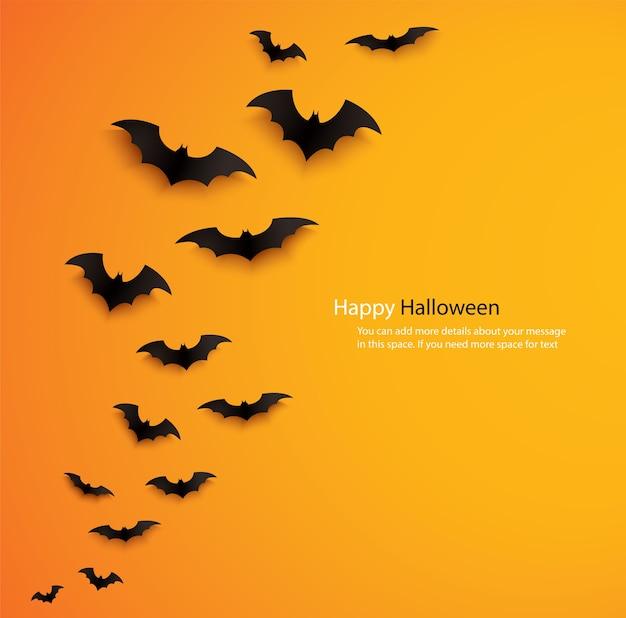 オレンジ色の背景の上を飛んでいるハロウィーンのコウモリ