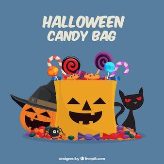 Halloween candies, pumpkin and cat