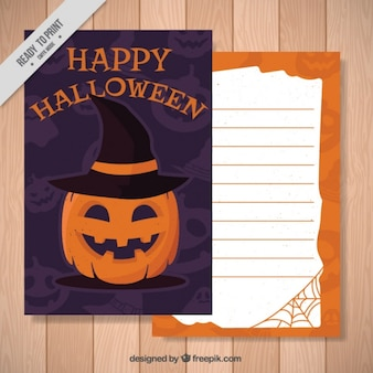 Halloween card of pumpkin with witch hat Free Vector
