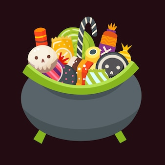 Halloween cauldron full of sweets, candies and desserts