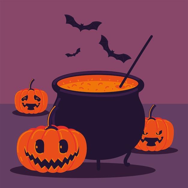 Halloween cauldron and pumpkins