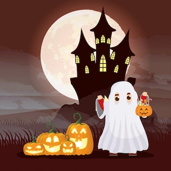 Halloween dark night scene with kid disguised ghost and pumpkins