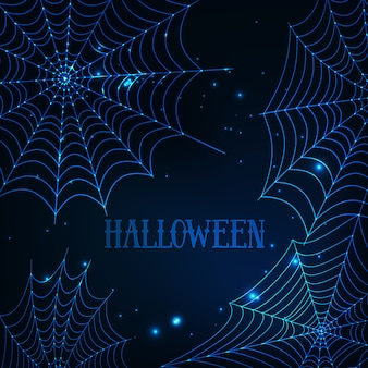 Halloween greeting card with glowing spider webs