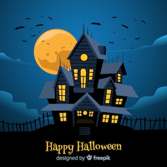 Halloween haunted house background in flat design