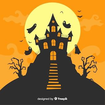 Дом с привидениями на хэллоуин с плоским дизайном