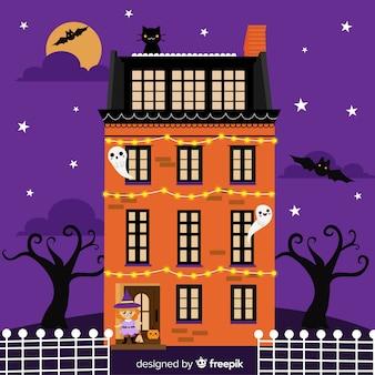 Halloween house background in flat design