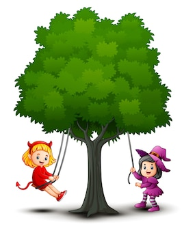 Halloween kids costumes play under the tree