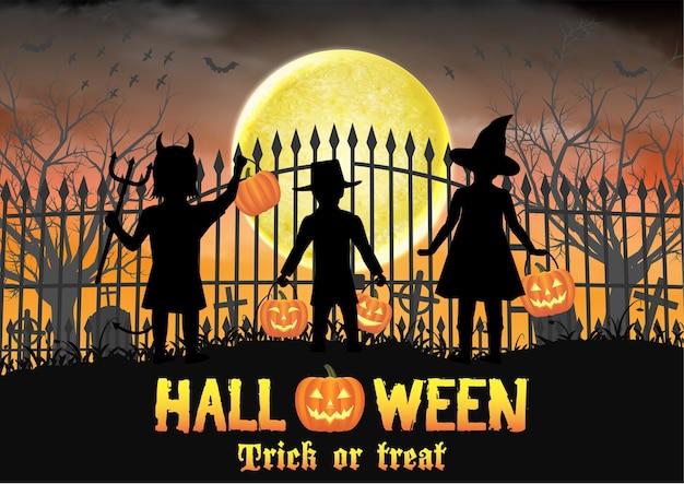 Halloween kids in front of graveyard cemetery gate