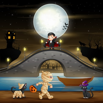 Halloween night with vampire, mummy and cats
