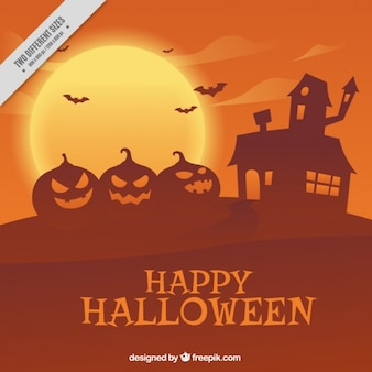 Halloween orange background of pumpkins and haunted house