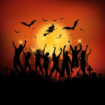 Halloween party background with silhouettes of people dancing